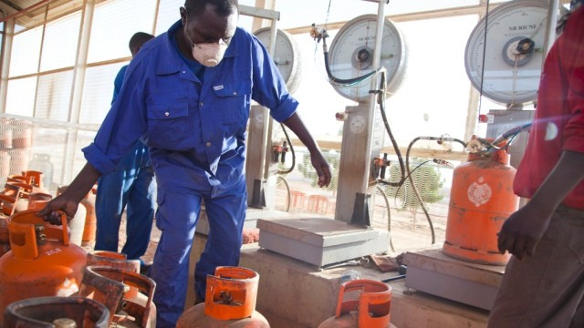 Refilling cooking gas cylinders in Sudan (file photo)