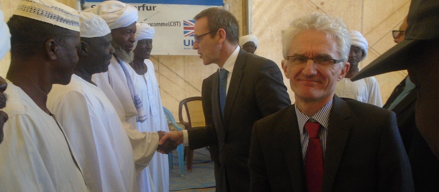 Head of the British Diplomatic Service Simon McDonald, and Department for International Development (DFID) Permanent Secretary Mark Lowcock shake hands with Sheikhs in Otash camp in South Darfur on Monday 9 January.
