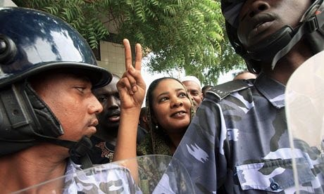 Lubna Hussein, journalist and UN press officer, detained for wearing trousers, gesturing outside the court after her trial in Khartoum in August 2009 (Reuters)