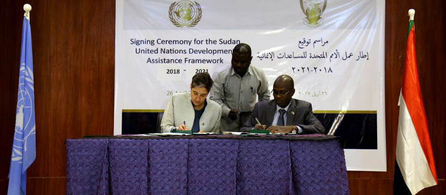 United Nations Resident and Humanitarian Coordinator in Sudan, Marta Ruedas and the Sudanese Minister of International Cooperation Osman Ahmed Fadul Wash sign the agreement in Khartoum today