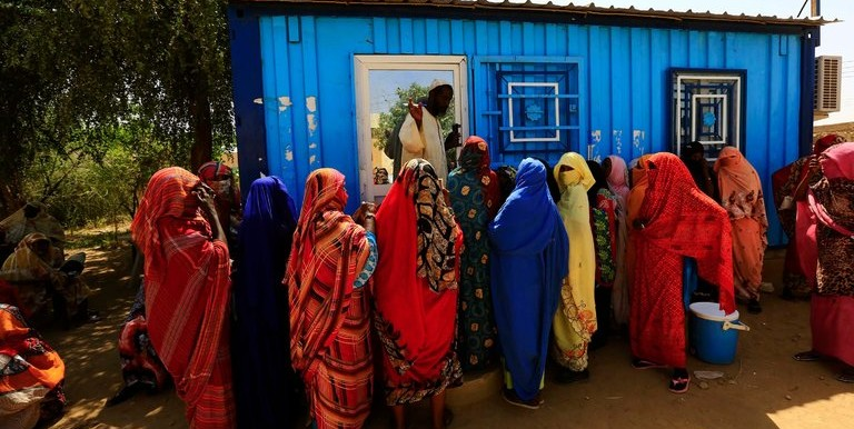 Eritrean asylum seekers meet at the Wad Sharify refugee camp in eastern Sudan, near the border with Eritrea (File photo: Mohamed Nureldin)