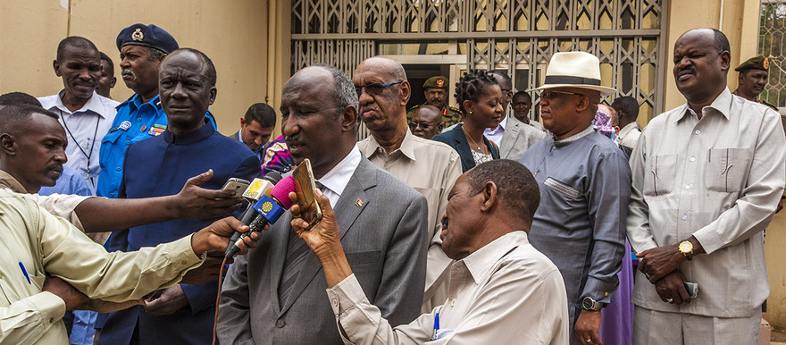 The head of the AU delegation, Ambassador Katende Mull of Uganda (blue suit) and the Governor of North Darfur, Abdul-Wahid Yusuf (speaker) address the press after their talks in El Fasher on Tuesday. (Amin Ismael / Unamid)