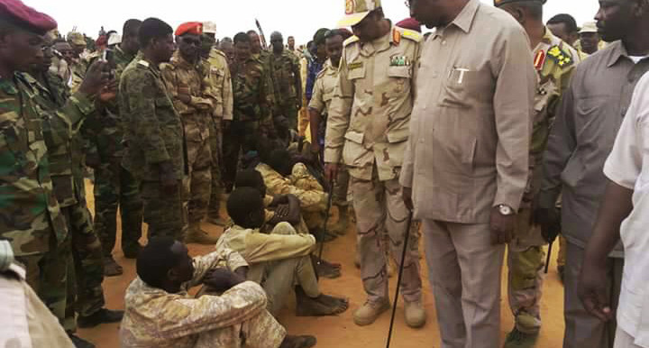RSF commander Lt. Gen. Mohamed Hamdan (aka Hemeti) (c) and the Governor of North Darfur Abdelwahid Yousef (r) inspect Prisoners of War in El Fasher yesterday - see more pictures below (Photo: Govt. of Sudan)