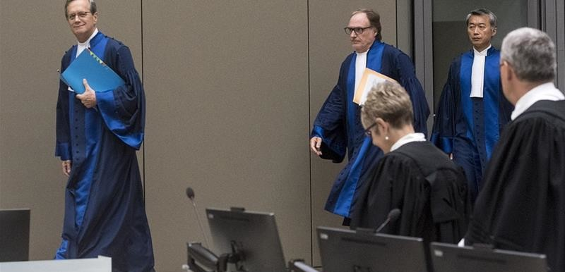 The Judges of ICC Pre-Trial Chamber II: Judge Marc Perrin de Brichambaut (left), Presiding Judge Cuno Tarfusser (center), Judge Chang-ho Chung (right) enter the hearing held on 6 July 2017 in The Hague, Netherlands (Evert Elzinga/AFP)
