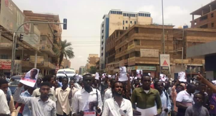 Students take to the streets of Khartoum yesterday in protest against a 'guilty' verdict condemning Asim Omar (see video and more pictures below) (RD)