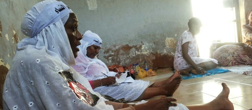 Members of the No Oppression Against Women Initiative in police custody in Omdurman, August 28, 2014 (RD)