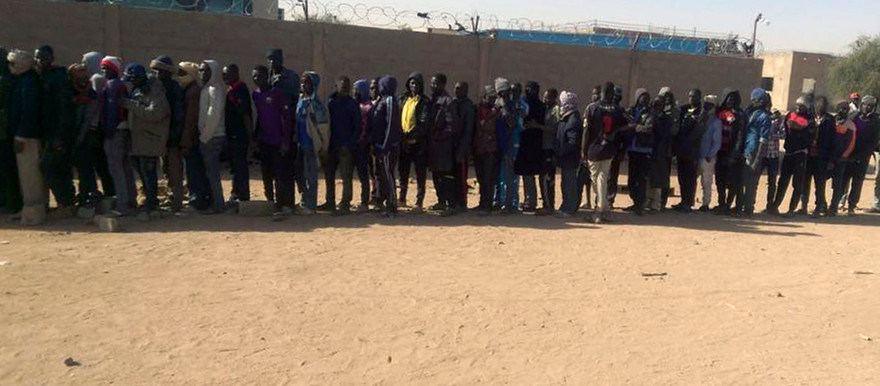 Sudanese refugees waiting to be loaded into trucks to be deported to Libya (IRIN)