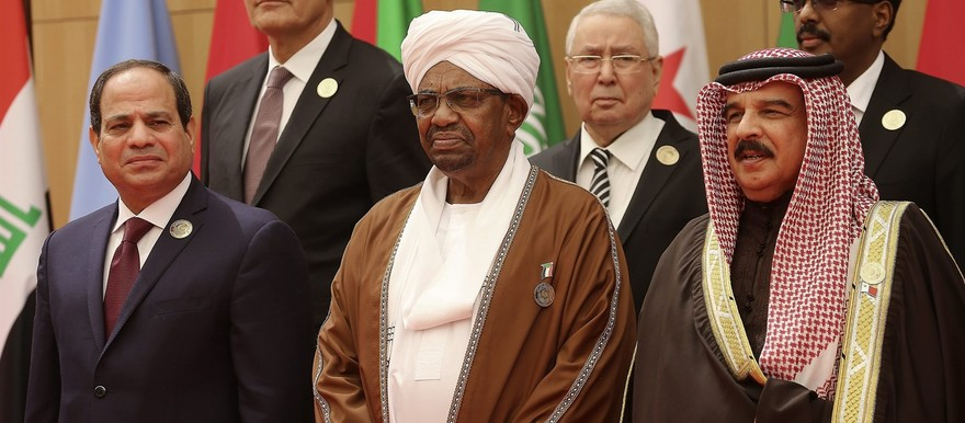 March 29, 2017: Al Bashir, center, stands between Egyptian president Abdel Fattah El Sisi, left, and Bahrain's King Hamad bin Isa Al Khalifa at the Arab League summit held in Jordan. Both Human Rights Watch and Amnesty International criticized Jordan's welcoming of Al Bashir despite a long-standing warrant for his arrest by the ICC (Raad Adayleh/AP Photo)