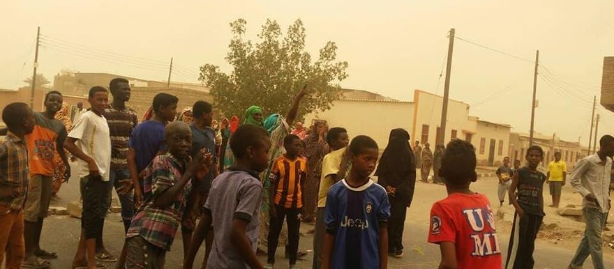 Gathered adults and children in Port Sudan, the state capital of Red Sea state (file photo)