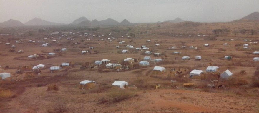 Temporary homes of displaced people in Libei. The plastic blankets that function as roofs are not newly provided blankets. (RD)