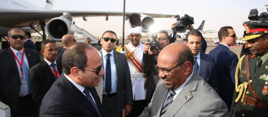 The Egyptian President, Abdelfattah Al Sisi, is greeted at Khartoum airport by Sudan's President Omar Al Bashir (Picture: SUNA)
