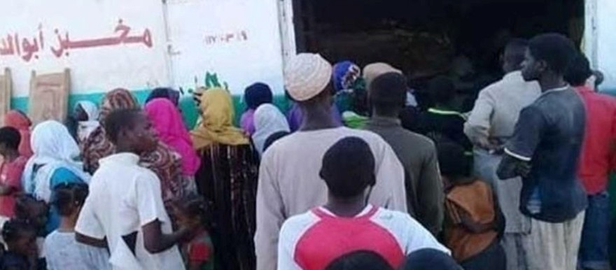 People waiting in line in front of a bakery in Sudan this week (RD)