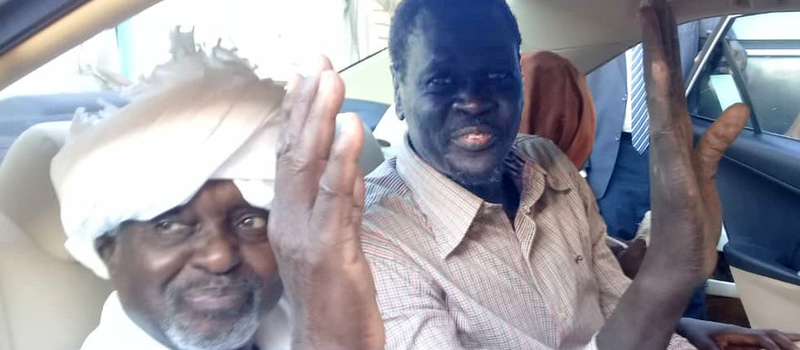 Ibrahim El Maaz Deng (right), a former leader of the Justice and Equality Movement (JEM), after his release from El Huda prison in Omdurman on Sunday, with Dr Ali El Haj, Secretary-General of the Popular Congress Party (left).