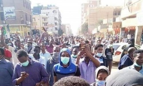 Marchers in Khartoum on Tuesday