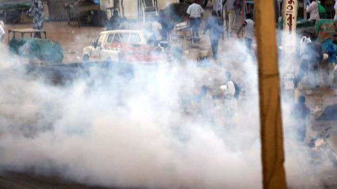 Clouds of tear gas waft over protesters in Khartoum