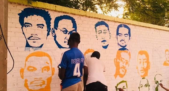Artists work on a mural commemorating the people killed during the Sudanese revolution