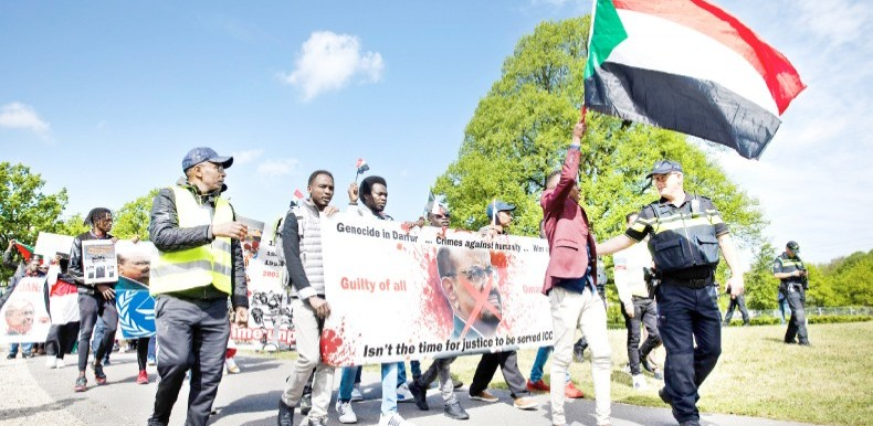 Sudanese march to the International Criminal Court in The Hague, demanding the trial of ousted President Omar Al Bashir, April 26, 2019 (AFP)