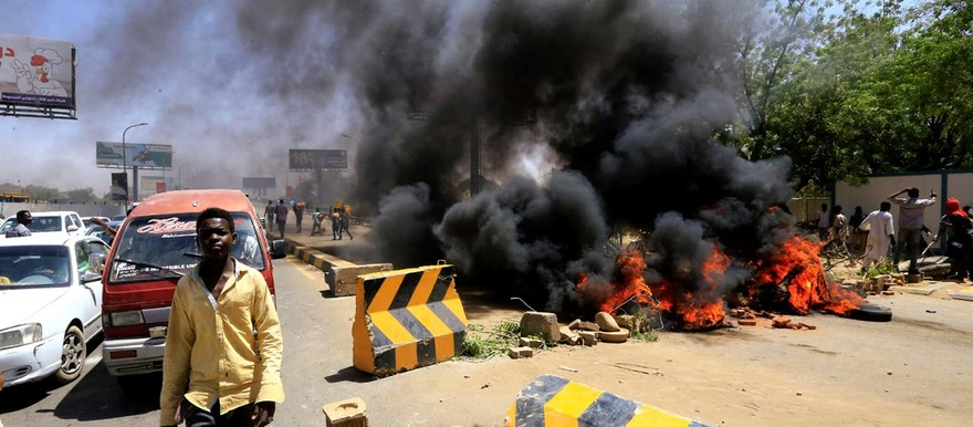 Barricades burn in Khartoum (Social media)