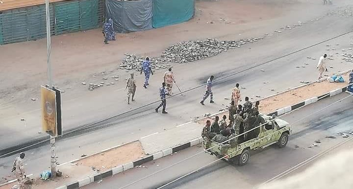 RSF elements clear barricades around the sit-in area in Khartoum today (RD)