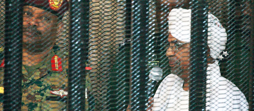 Al Bashir hears charges against him from a security cage in the Khartoum court in August (Social media)