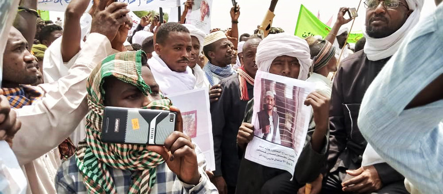 Relatives of former Janjaweed leader Musa Hilal and his followers, currently facing a Court Martial in Khartoum, demonstrate for their release in Misteriya, North Darfur on Sunday (RD Correspondent)