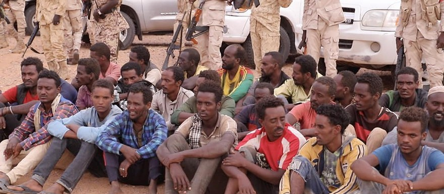 Some of the 107 migrants rescued in the desert near the Libyan border (SUNA)