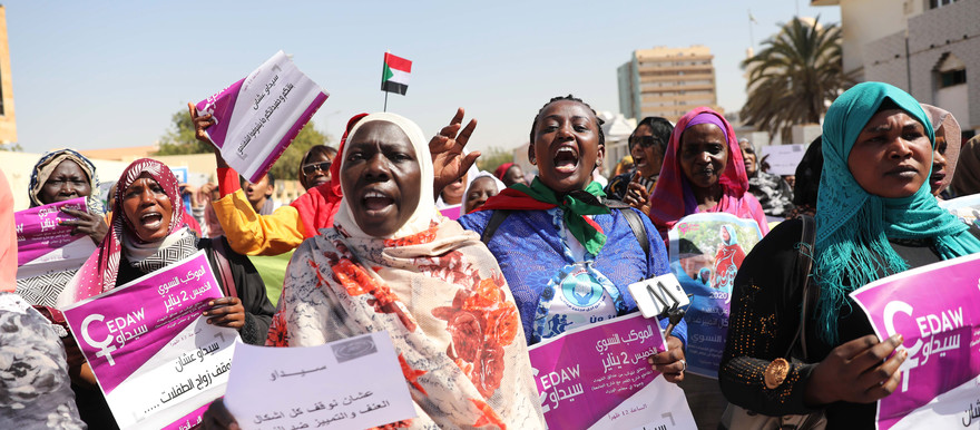 Sudanese women hold placards demanding equal pay for equal efforts and Sudan to join the international community in ending discriminatory laws against women as they gather for a demonstration in Khartoum, Sudan, 02 January 2020 (Picture: EPA/MORWAN ALI)