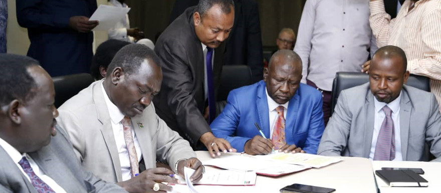 The delegations of the Sudanese Government and the Malik Agar faction of the Sudan People's Liberation Movement-North (SPLM-N Agar) initial a Political Document at the Sudanese peace talks in the South Sudan capital Juba on Saturday (SUNA)