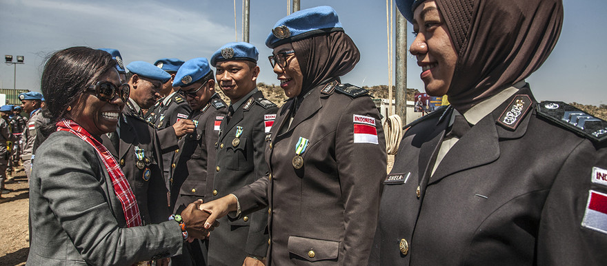 Unamid Deputy Joint Special Representative (DJSR) Anita Kiki Gbeho, meets Indonesian peacekeepers during a visit the Mission's Temporary Operating Base (TOB) in Golo, Central Darfur, in February (Photo: Mohamad Almahady / Unamid)