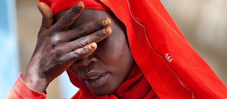 A woman living in Kassab Camp for Internally Displaced People in Kutum, North Darfur, expresses her sorrow over the increase in rapes in the area (UN Photo / Albert González Farran)