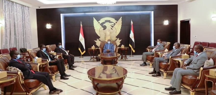 Lt Gen Abdelfattah El Burhan, Chairman of the Sovereign Council, receives South Sudan peace mediators and rebel leaders in Khartoum (SUNA)
