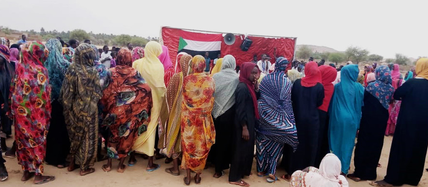 The sit-in in the Fata Borno camp for the displaced in North Darfur's Kutum on July 8 (RD). The protestors called for security in the area. Five days later, at least 10 people were killed in a militia attack on the sit-in.
