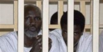 Two members of the Darfuri Justice and Equality Movement attend their trial session in Omdurman,  20 August, 2008 (AFP)