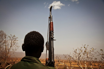 A Sudan People's Liberation Movement-North rebel soldier looks out toward Talodi in South Kordofan (AFP)