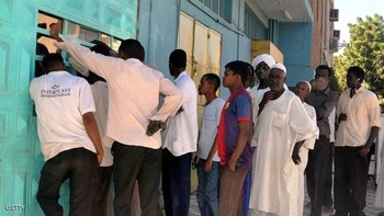 Waiting to buy bread in Sudan (file photo)