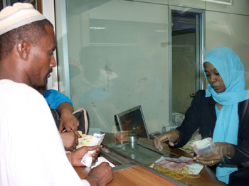 A man is changing money at a forex office in Khartoum (file photo)