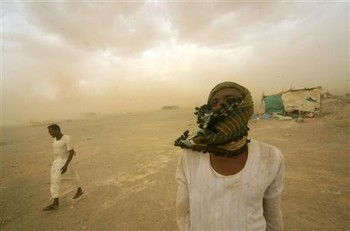 Gold mine workers walk to their shelter during a sandstorm in River Nile state (Mohamed Nureldin Abdallah/Reuters)