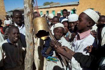 An old shell casing serves as a bell at this basic school in Darfur (File photo)