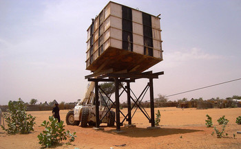 Water tank installed by Unamid at the Neem camp for the displaced near El Daein, East Darfur, in March 2015. Severe shortages forced the camp residents to walk long distances in search of water. (Tahir Khurshid/Unamid)