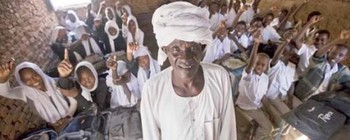 A basic school teacher with his class in Darfur (File photo)