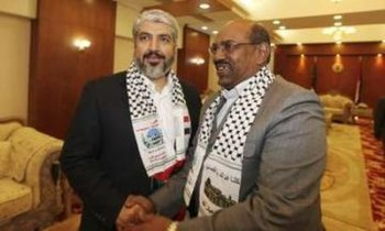 President Omar al Bashir welcomes Hamas's political chief Khaled Meshaal in Khartoum March 6, 2011. (Photo Reuters)
