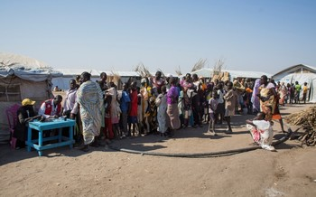 In Alagaya Refugee Camp, a group of refugees from South Sudan queue to have their ration cards verified by the Sudanese Red Crescent Society staff (WFP)
