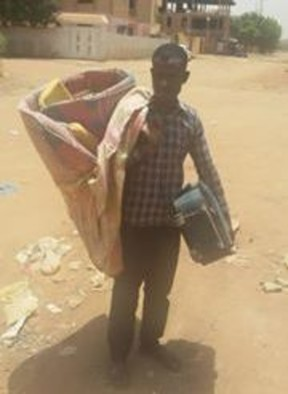 A student walks with his luggage after being evicted from a dormitory in Khartoum North on 15 July 2015 (RD)