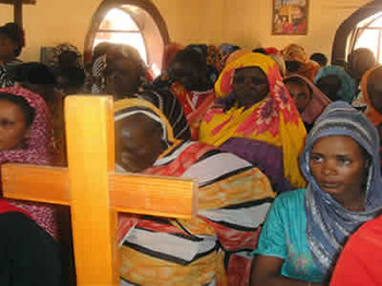 Christian women worshipping in a Sudanese church (barnabasfund.org)