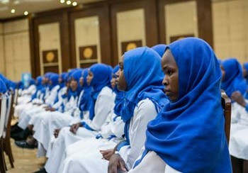 Darfuri women who have completed their midwife training attend a graduation ceremony at Friendship Hall in Khartoum (File photo)