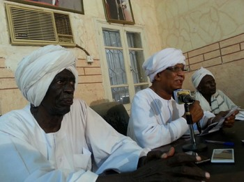 Mohamed El Khateeb (C) and Siddig Yousef Hussein (L) at a press conference of the Communist Party of Sudan, Khartoum (RD)