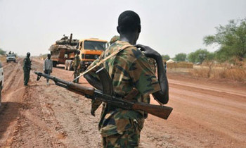 A Sudanese soldier patrolling in South Darfur (file photo)