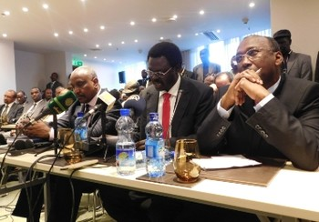 Flanked by SPLM-N SG Yasir Arman and JEM chief negotiator Ahmed Tugud, SLM Minni Minnawi (C) speaks at the opening session of the AUHIP brokered session in Addis Ababa on 19 November 2015 (ST Photo)
