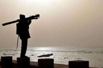 A Libyan opposition fighter manages a mobile anti-aircraft gun in Ajdabiya, Libya (upi.com)