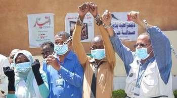 Sudanese journalists gather outside the office of El Tayar newspaper to announce their hunger strike, 1 March 2016 (Ashraf Shazly/AFP/Getty Images)
